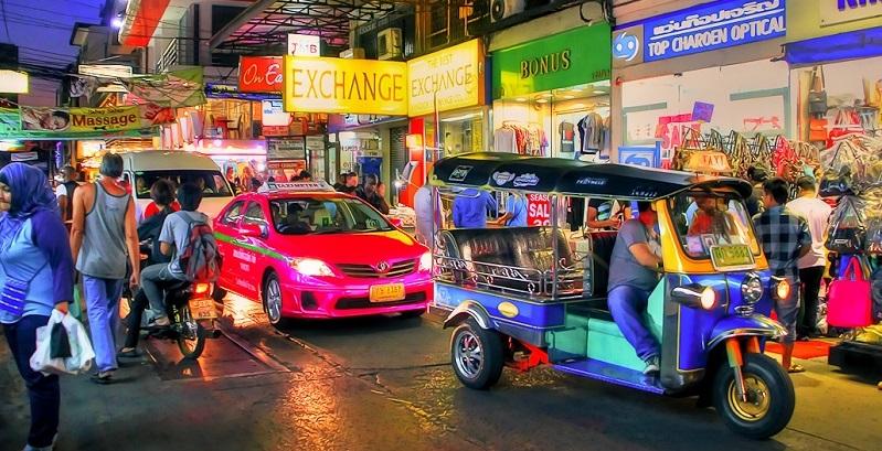 Tuk Tuk and Taxi at the Night MArket in Pratunam Bangkok Thailand